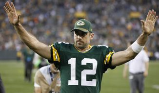 Green Bay Packers' Aaron Rodgers celebrates after an NFL football game against the Cincinnati Bengals Sunday, Sept. 24, 2017, in Green Bay, Wis. The Packers won 27-24 in overtime. (AP Photo/Mike Roemer)