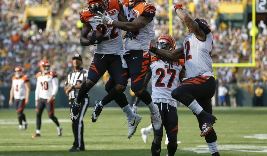 Cincinnati Bengals' William Jackson celebrates his interception and return for a touchdown with teammate Joe Mixon during the first half of an NFL football game against the Green Bay Packers Sunday, Sept. 24, 2017, in Green Bay, Wis. (AP Photo/Matt Ludtke)