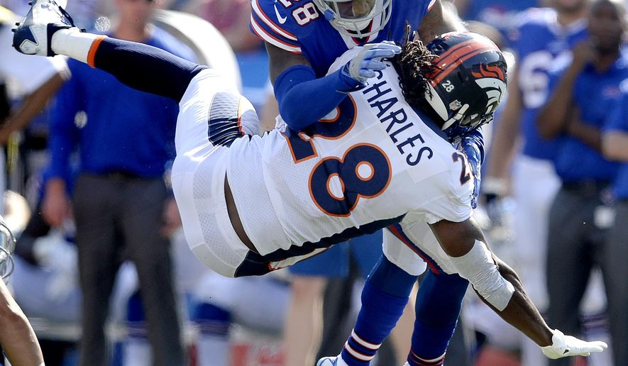 Buffalo Bills cornerback E.J. Gaines, top, makes a hit on Denver Broncos running back Jamaal Charles during the second half of an NFL football game, Sunday, Sept. 24, 2017, in Orchard Park, N.Y. (AP Photo/Adrian Kraus)