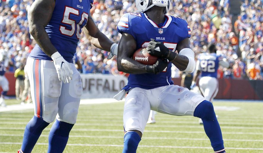 Buffalo Bills cornerback Tre'Davious White, right, and outside linebacker Ramon Humber celebrate White's interception on a pass from Denver Broncos quarterback Trevor Siemian, not pictured, during the second half of an NFL football game, Sunday, Sept. 24, 2017, in Orchard Park, N.Y. (AP Photo/Jeffrey T. Barnes)