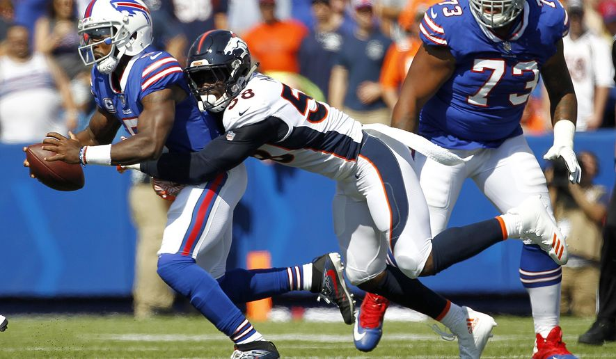 Buffalo Bills quarterback Tyrod Taylor, left, is sacked by Denver Broncos outside linebacker Von Miller during the first half of an NFL football game, Sunday, Sept. 24, 2017, in Orchard Park, N.Y. (AP Photo/Jeffrey T. Barnes)