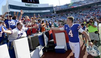 Buffalo Bills kicker Stephen Hauschka (4) sprays a fan with his water bottle after an NFL football game against the Denver Broncos, Sunday, Sept. 24, 2017, in Orchard Park, N.Y. (AP Photo/Adrian Kraus)