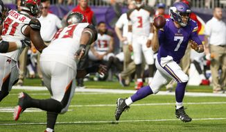 Minnesota Vikings quarterback Case Keenum (7) scrambles up field during the second half of an NFL football game against the Tampa Bay Buccaneers, Sunday, Sept. 24, 2017, in Minneapolis. The Vikings won 34-17. (AP Photo/Bruce Kluckhohn)