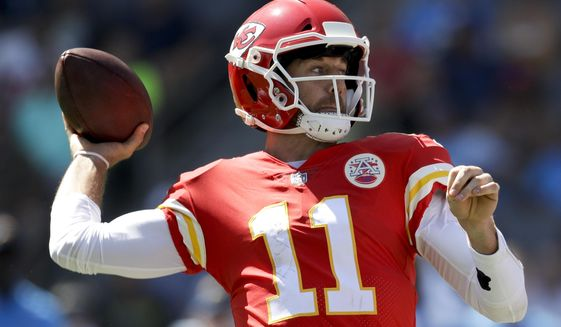 Kansas City Chiefs quarterback Alex Smith passes against the Los Angeles Chargers during the first half of an NFL football game Sunday, Sept. 24, 2017, in Carson, Calif. (AP Photo/Jae C. Hong)