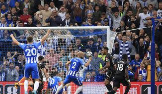 CAPTION CORRECTS BRISTOL TO NEWCASTLE Brighton's Tomer Hemed centre, sat on pitch,  scores his side's first goal of the game during the English Premier League soccer match between Brighton and Newcastle at the AMEX Stadium, Brighton, England,  Sunday Sept. 24, 2017. (John Walton/PA via AP)
