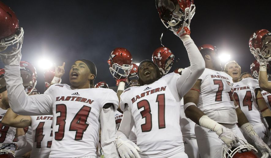 Eastern Washington players sing the fight song to their fans after playing Montana in an NCAA college football game Saturday, Sept. 23, 2017, in Missoula, Mont. Eastern Washington won 48-41. (AP Photo/Patrick Record)