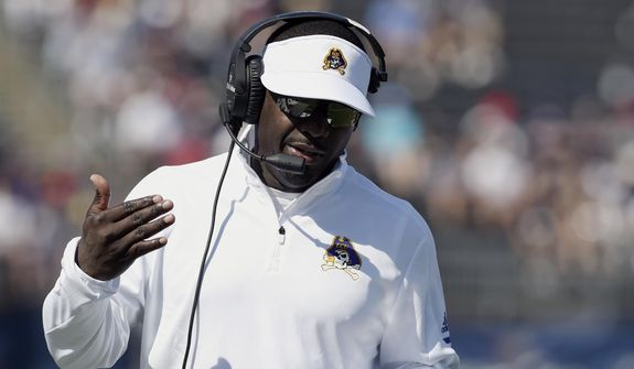 East Carolina head coach Scottie Montgomery talks on his headset during the first half of an NCAA college football game against Connecticut, Sunday, Sept. 24, 2017, in East Hartford, Conn. (AP Photo/Jessica Hill) ** FILE **