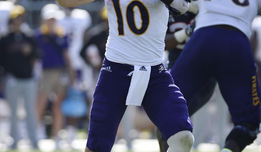 East Carolina quarterback Thomas Sirk (10) throws during the second half of an NCAA college football game against Connecticut, Sunday, Sept. 24, 2017, in East Hartford, Conn. (AP Photo/Jessica Hill)