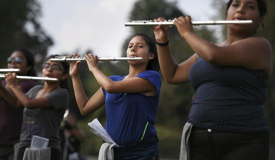 """Irais """"Julie"""" Vazquez, 17 and her bandmates at Passaic High School practice on Saturday, Sept. 16, 2017. The marching band is consistently one of the best bands in New Jersey. (Michael Karas/The Record via AP)"""