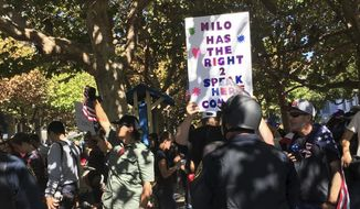 Berkeley Police officers stand guard for planned speech by Milo Yiannopoulos in Berkeley, Calif., Sunday, Sept. 24, 2017. Milo Yiannopoulos was whisked away in a car after a brief appearance at the school that drew a few dozen supporters and a slightly larger crowd protesting the right-wing provocateur. (AP Photo/Daisy Nguyen)