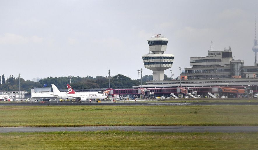 This Sept. 23, 2017 photo shows an overview of Tegel Airport in Berlin, Germany. During the German parliament election, Sunday, Sept. 24, 2017 Berlin residents are also called to decide on the future of Tegel airport. (Paul Zinken/dpa via AP)