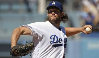 Los Angeles Dodgers pitcher Clayton Kershaw throws to the plate during the second inning of a baseball game against the San Francisco Giants, Sunday, Sept. 24, 2017, in Los Angeles. (AP Photo/Michael Owen Baker)