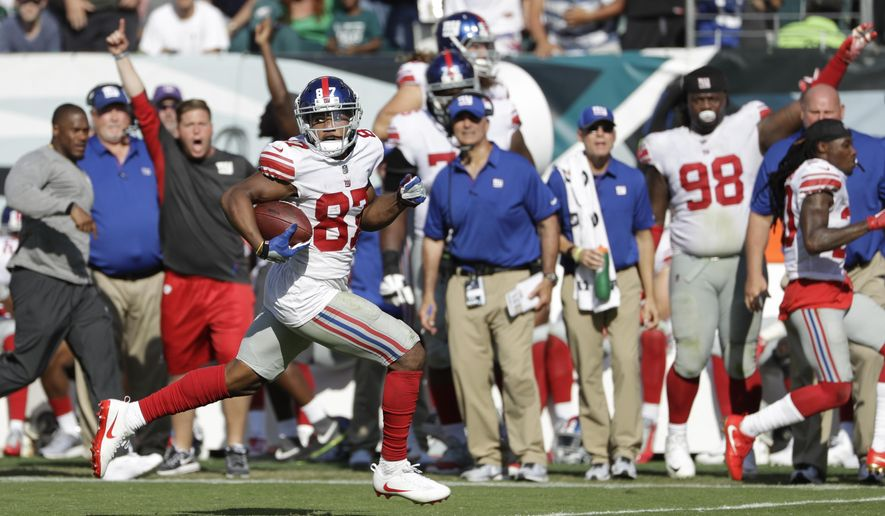 New York Giants' Sterling Shepard scores a touchdown during the second half of an NFL football game against the Philadelphia Eagles, Sunday, Sept. 24, 2017, in Philadelphia. (AP Photo/Michael Perez)