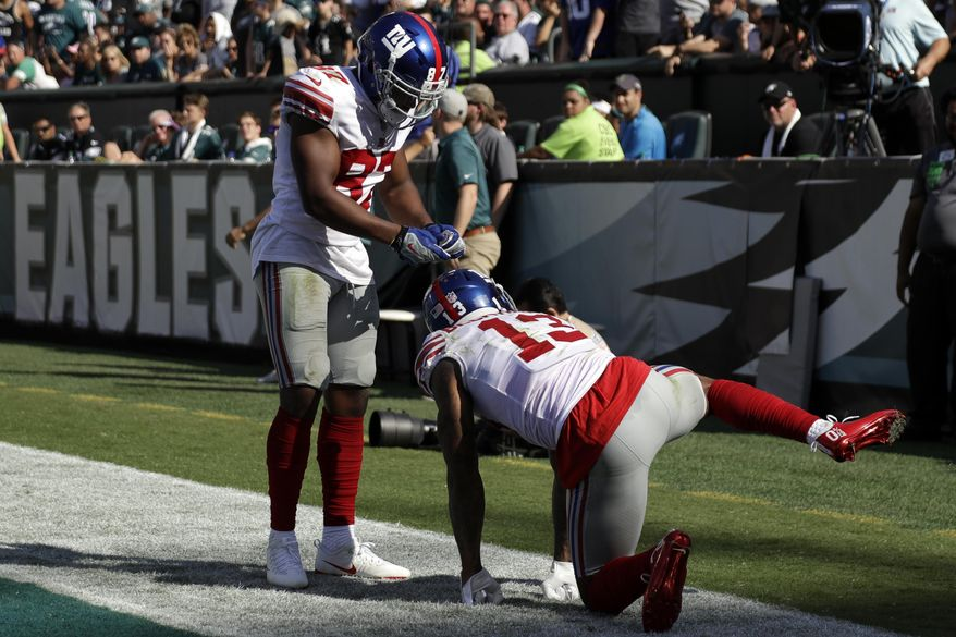 New York Giants' Odell Beckham, right, celebrates with Sterling Shepard after a touchdown during the second half of an NFL football game against the Philadelphia Eagles, Sunday, Sept. 24, 2017, in Philadelphia. (AP Photo/Michael Perez)