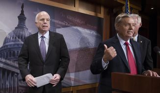 "In this July 27, 2017, file photo, Sen. John McCain, R-Ariz., left, walks onstage as Lindsey Graham, R-S.C., center, points to him while Sen. Ron Johnson, R-Wis., watches as they speak to reporters at the Capitol as the Republican-controlled Senate was unable to fulfill its political promise to repeal and replace ""Obamacare"" because of opposition and wavering within the GOP ranks. (AP Photo/Cliff Owen, File)"