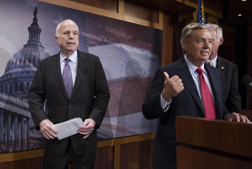 """In this July 27, 2017, file photo, Sen. John McCain, R-Ariz., left, walks onstage as Lindsey Graham, R-S.C., center, points to him while Sen. Ron Johnson, R-Wis., watches as they speak to reporters at the Capitol as the Republican-controlled Senate was unable to fulfill its political promise to repeal and replace """"Obamacare"""" because of opposition and wavering within the GOP ranks. (AP Photo/Cliff Owen, File)"""