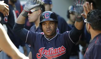 Cleveland Indians' Jose Ramirez is greeted in the dugout after he hit a solo home run against the Seattle Mariners in the sixth inning of a baseball game, Sunday, Sept. 24, 2017, in Seattle. (AP Photo/Ted S. Warren)
