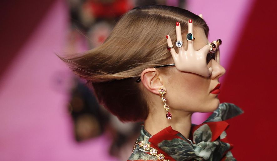 A model wears a creation as part of the Dolce & Gabbana womens Spring/Summer 2018/19 fashion collection, presented in Milan, Italy, Sunday, Sept. 24, 2017. (AP Photo/Antonio Calanni)
