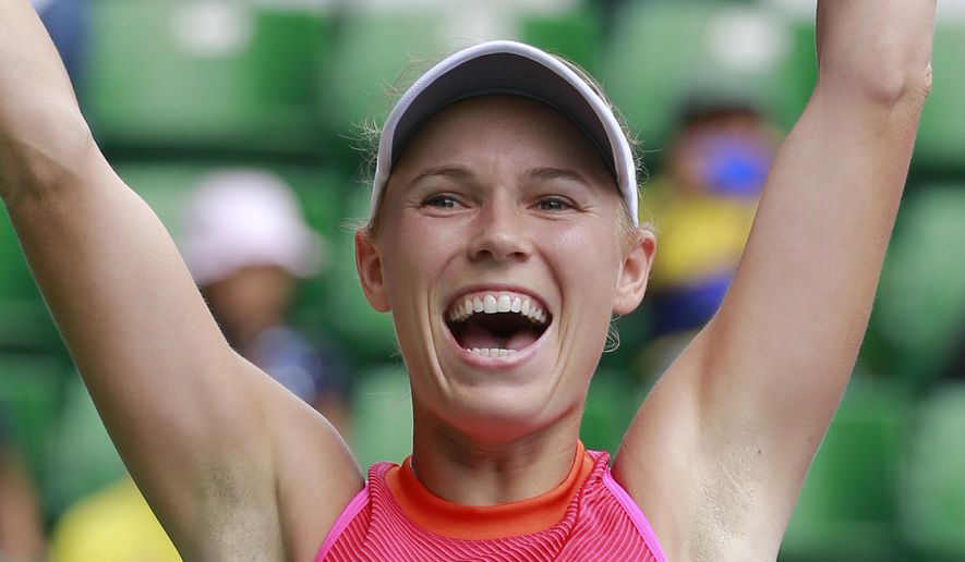Caroline Wozniacki of Denmark celebrates after winning over Anastasia Pavlyuchenkova of Russia at the Pan Pacific Open tennis tournament in Tokyo, Sunday, Sept. 24, 2017. (AP Photo/Shizuo Kambayashi)