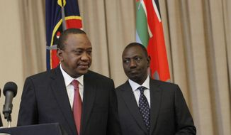 Kenya's President Uhuru Kenyatta, left, accompanied by Deputy President William Ruto, right, leaves after speaking to the media at State House in Nairobi, Kenya Thursday, Sept. 21, 2017. Kenya's electoral commission has announced it has moved the date for a fresh presidential election to Oct 26. The electoral commission had earlier set Oct 17 as the date for the fresh poll after the Supreme Court invalidated President Uhuru Kenyatta's August re-election and ordered a rerun within 60 days. (AP Photo/Khalil Senosi)