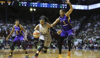 Minnesota Lynx forward Maya Moore (23) drives the ball around Los Angeles Sparks center Candace Parker (3) in the first half of Game 1 in the WNBA basketball final, Sunday, Sept. 24, 2017, in Minneapolis. (AP Photo/Stacy Bengs)