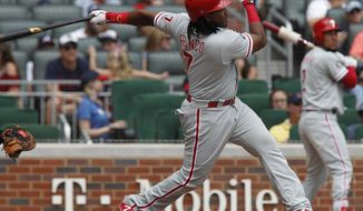 Philadelphia Phillies' Maikel Franco hits a solo home run against the Atlanta Braves in the fifth inning of a baseball game in Atlanta, Sunday, Sept. 24, 2017. (AP Photo/Tami Chappell)