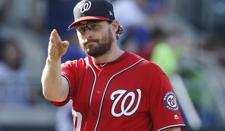 Washington Nationals second baseman Daniel Murphy gestures after a victory over the New York Mets in a baseball game, Sunday, Sept. 24, 2017, in New York. (AP Photo/Kathy Willens)