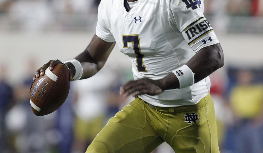 Notre Dame quarterback Brandon Wimbush rolls out before throwing a touchdown pass against Michigan State during the second quarter of an NCAA college football game, Saturday, Sept. 23, 2017, in East Lansing, Mich. (AP Photo/Al Goldis)