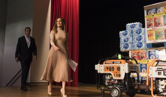 Governor Andrew Cuomo, left and Jennifer Lopez walk on stage before announcing new hurricane recovery efforts for Puerto Rico Sunday, Sept. 24, 2017 in New York. (AP Photo/Michael Noble Jr.)