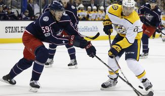 Nashville Predators' Kevin Fiala, right, of Switzerland, tries to shoot the puck past Columbus Blue Jackets' Ryan Collins during the first period of an NHL preseason hockey game Sunday, Sept. 24, 2017, in Columbus, Ohio. (AP Photo/Jay LaPrete)