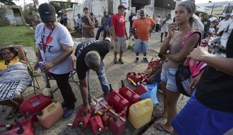 Hundreds of people wait in line since the morning to buy gasoline three days after the impact of Hurricane Maria in Carolina, Puerto Rico, Saturday, Sept. 23, 2017. A humanitarian crisis grew Saturday in Puerto Rico as towns were left without fresh water, fuel, power or phone service following Hurricane Maria's devastating passage across the island. (AP Photo/Carlos Giusti)