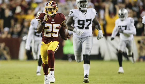 Washington Redskins running back Chris Thompson (25) carries the ball during the second half of an NFL football game against the Oakland Raiders in Landover, Md., Sunday, Sept. 24, 2017. (AP Photo/Mark Tenally)
