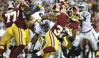 Washington Redskins running back Samaje Perine (32) carries the ball during the first half of an NFL football game against the Oakland Raiders in Landover, Md., Sunday, Sept. 24, 2017. (AP Photo/Alex Brandon)
