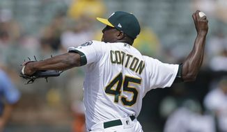 Oakland Athletics pitcher Jharel Cotton works against the Texas Rangers in the second inning of a baseball game, Sunday, Sept. 24, 2017, in Oakland, Calif. (AP Photo/Ben Margot)
