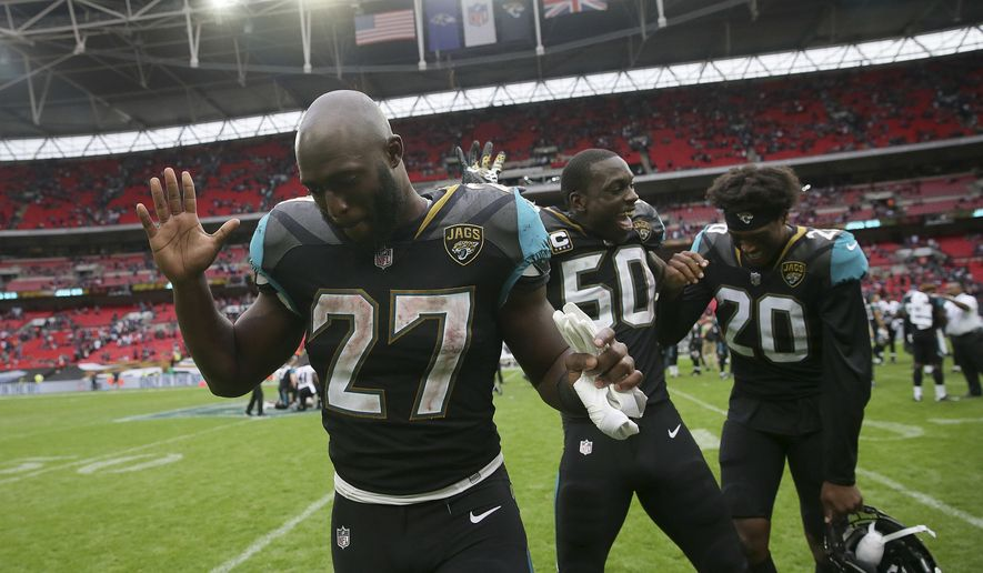 Jacksonville Jaguars running back Leonard Fournette, from left, Telvin Smith and Jalen Ramsey react as they leave the field after an NFL football game against the Baltimore Ravens at Wembley Stadium in London, Sunday Sept. 24, 2017. The Jaguars won the match 44-7. (AP Photo/Tim Ireland)