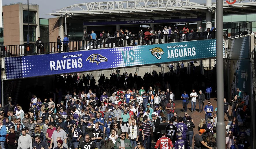 Fans walk up Wembley Way as they arrive for an NFL football game between the Jacksonville Jaguars and the Baltimore Ravens at Wembley Stadium in London, Sunday Sept. 24, 2017. (AP Photo/Matt Dunham)