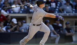 Colorado Rockies' Pat Valaika watches his solo home run against the San Diego Padres during the ninth inning of a baseball game in San Diego, Sunday, Sept. 24, 2017. (AP Photo/Alex Gallardo)