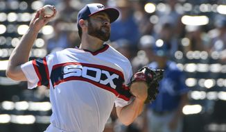 Chicago White Sox starting pitcher Lucas Giolito (27) delivers against the Kansas City Royals during the first inning of a baseball game in Chicago on Sunday, Sept. 24, 2017. (AP Photo/Matt Marton)