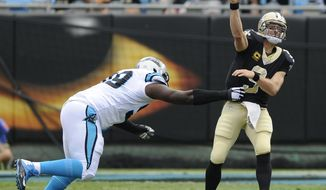 New Orleans Saints' Drew Brees (9) throws a pass under pressure from Carolina Panthers' Kawann Short (99) in the first half of an NFL football game in Charlotte, N.C., Sunday, Sept. 24, 2017. (AP Photo/Mike McCarn)