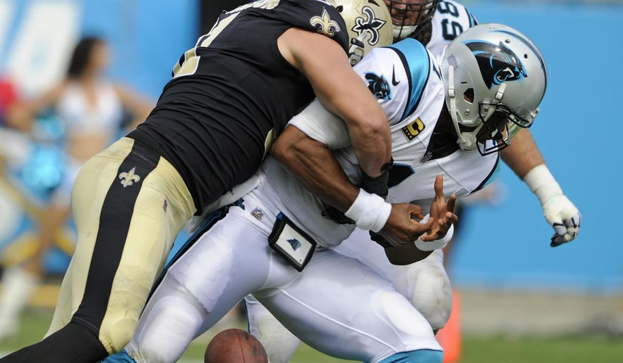 Carolina Panthers' Cam Newton (1) loses the ball as he is sacked by New Orleans Saints' Trey Hendrickson (91) in the second half of an NFL football game in Charlotte, N.C., Sunday, Sept. 24, 2017. The Panthers recovered the ball. (AP Photo/Mike McCarn)