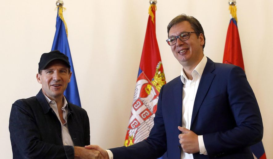 British actor and director Ralph Fiennes, left, shakes hands with Serbian President Aleksandar Vucic, during a meeting, in Belgrade, Serbia, Sunday, Sept. 24, 2017. Fiennes has received Serbian passport from the Balkan country's president after he was granted Balkan country's citizenship. (AP Photo/Darko Vojinovic)
