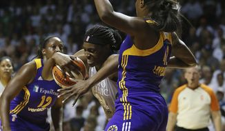 Minnesota Lynx center Sylvia Fowles (34) tries to push the ball through the defense of Los Angeles Sparks center Jantel Lavender (42) in the first half of Game 1 in the WNBA basketball finals game, Sunday, Sept. 24, 2017, in Minneapolis. (AP Photo/Stacy Bengs)