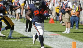 Chicago Bears running back Jordan Howard (24) runs to the end zone for a touchdown in overtime of an NFL football game against the Pittsburgh Steelers, Sunday, Sept. 24, 2017, in Chicago. The Bears won 23-17 in overtime. (AP Photo/Charles Rex Arbogast)