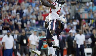 Houston Texans safety Corey Moore (43) breaks up a pass intended for New England Patriots wide receiver Brandin Cooks (14) during the second half of an NFL football game, Sunday, Sept. 24, 2017, in Foxborough, Mass. (AP Photo/Michael Dwyer)