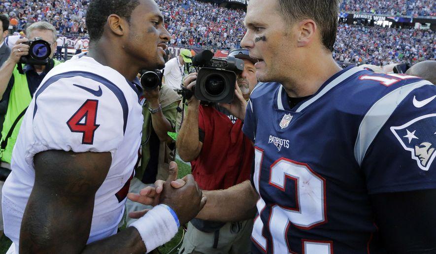 Houston Texans quarterback Deshaun Watson, left, and New England Patriots quarterback Tom Brady speak at midfield after an NFL football game, Sunday, Sept. 24, 2017, in Foxborough, Mass. (AP Photo/Steven Senne)