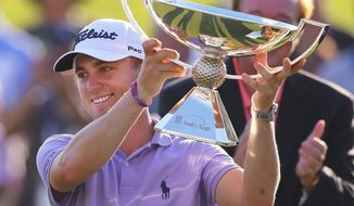 Justin Thomas holds the trophy after winning the Fedex Cup after the Tour Championship golf tournament at East Lake Golf Club in Atlanta, Sunday, Sept. 24, 2017, in Atlanta. (Curtis Compton/Atlanta Journal-Constitution via AP)