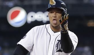 Detroit Tigers' Miguel Cabrera tosses his bat after receiving a base on balls during the first inning of a baseball game against the Minnesota Twins, Thursday, Sept. 21, 2017, in Detroit. (AP Photo/Carlos Osorio)