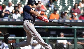 Minnesota Twins' Zack Granite (8) hits a sacrifice fly during the fourth inning of a baseball game against the Detroit Tigers, Sunday, Sept. 24, 2017, in Detroit. (AP Photo/Jose Juarez)