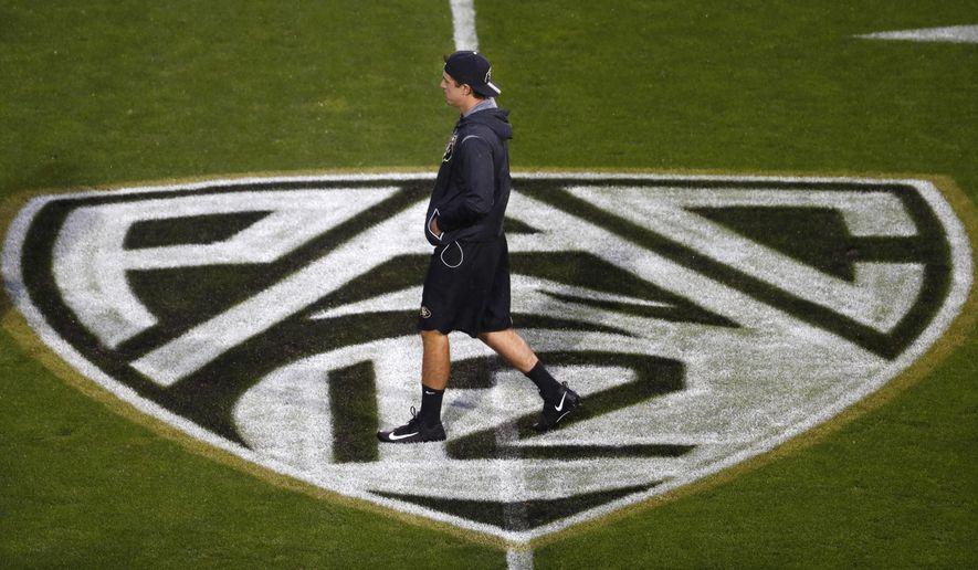 A Colorado player checks the field as rain falls at Folsom Field before Colorado played Washington in an NCAA college football game Saturday, Sept. 23, 2017, in Boulder, Colo. (AP Photo/David Zalubowski)