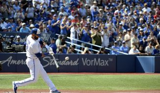Toronto Blue Jays' Jose Bautista hits a single in front of an applauding crowd against the New York Yankees during the first inning of a baseball game Sunday, Sept. 24, 2017, in Toronto. (Jon Blacker/The Canadian Press via AP)